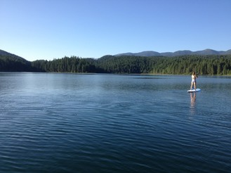 cool off in an alpine lake with a paddleboard rental